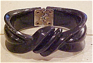 Black plastic hinged bangle (Image1)