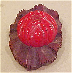 Red carved bakelite and wood dress clip (Image1)