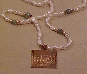 Freshwater pearl necklace w/calendar charm (Image1)