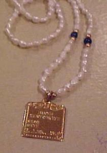 Freshwater pearl necklace w/birth cert. charm (Image1)