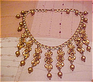Festoon style plastic necklace (Image1)