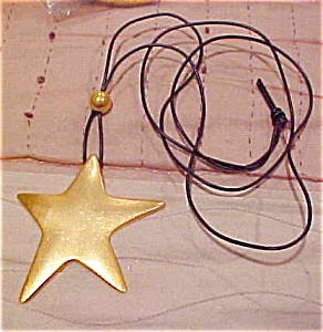 Star pendant on cord (Image1)