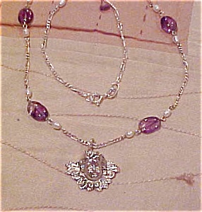 Contemporary cherub necklace (Image1)