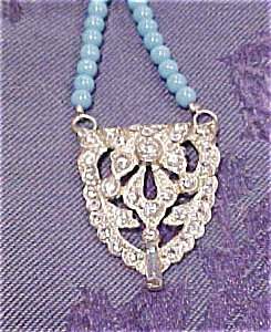 Art deco pendant on beads (Image1)