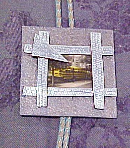 Bolo tie with picture of yellow bus (Image1)
