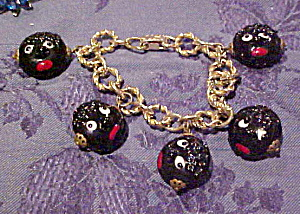 Charm bracelet with glass face charms (Image1)