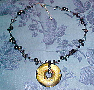 Contemporary necklace with glass pendant (Image1)
