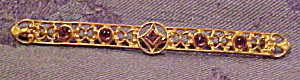 Art Nouveau bar pin with amethyst glass (Image1)