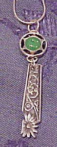 Cufflink and silverware pendant (Image1)