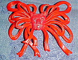 Red plastic bow pin with dog (Image1)
