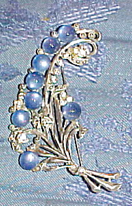 Flower brooch with blue cabochons (Image1)