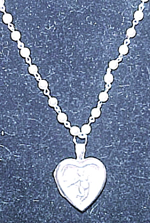 Sterling silver angel locket on faux pearls (Image1)