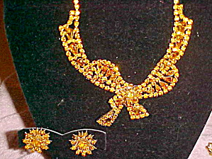 Topaz rhinestone bow necklace and earrings (Image1)