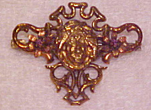 Art nouveau brooch with genie (Image1)