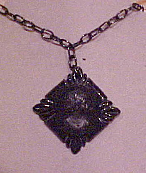 Black Bakelite cameo pendant on chain (Image1)
