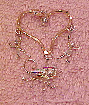 Heart charm with cat and 2 people  (Image1)
