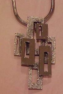 Tortolani  silvertone modern pendant (Image1)
