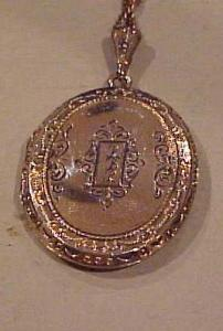 Gold filled engraved locket on chain (Image1)