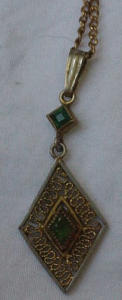 Emerald colored glass pendant on chain (Image1)