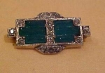 Art Deco pin with green glass