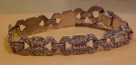 Click here to enlarge image and see more about item b1084: Pot metal bracelet w/rhinestones