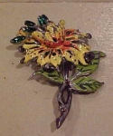 Enameled flower pin w/green rhinestones
