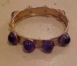 Hinged bangle with blue cabachons
