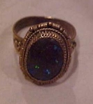 Brass ring with opalescent stone