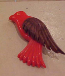 Red bakelite bird pin with wood wing