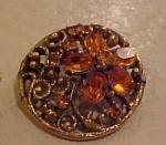 Circular pin w/topaz rhinestones flower