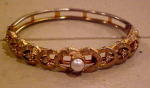 Goldtone bangle w/faux pearl & rhinestones