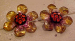 Plastic flower earrings with rhinestones