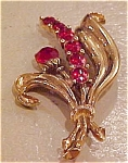 Flower pin with red rhinestones
