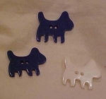 3 bakelite dog buttons