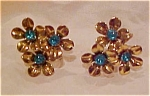 Flower earrings with blue rhinestones