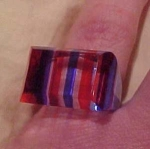Lucite ring with blue and red stripes
