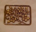 Brass floral design pin