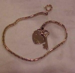 Charm bracelet with heart and key