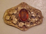 Art Nouveau sash pin with topaz glass