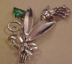 Sterling flower pin w/green rhinestone
