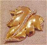 Goldtone leaf pin with rhinestones