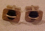 Destino goldtone and onyx cufflinks