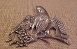 Double bird pin