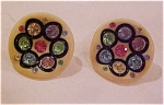 Thermoplastic earrings with rhinestones