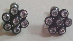 Black plastic earrings with clear rhinestones