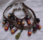 Click here to enlarge image and see more about item cc392: Braided cord necklace & Bracelet w/charms