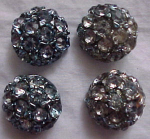 Four blue rhinestone and metal buttons