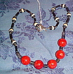 Black and white bead necklace with red balls