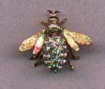 Click here to enlarge image and see more about item e246: Goldtone bug with clear rhinestones in body