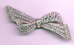 Art deco pot metal and rhinestone bow pin